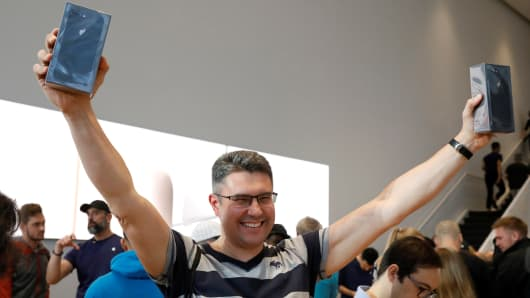 One of the first customers celebrates his purchase of the new iPhone 8 at the 5th Avenue Apple store in New York City, U.S., September 22, 2017.