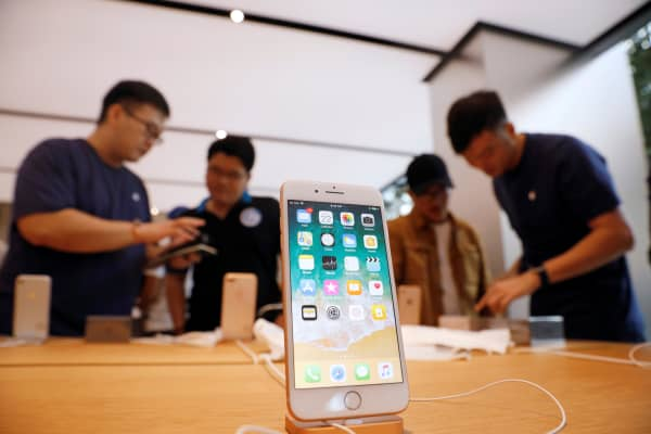 People buy the iPhone 8 at the Apple Orchard Shop in Singapore September 22, 2017.