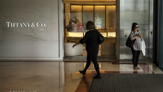Pedestrians walk past the entrance to a Tiffany & Co. jewelry store in the central business district of Kuala Lumpur, Malaysia.