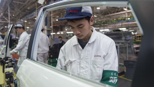 Employees work on the Honda Civic production line at the automaker's Dongfeng Honda factory in Wuhan, China.