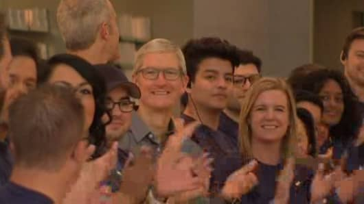 Apple CEO Tim Cook cheers alongside Apple Store employees in Palo Alto, Calif. for the launch of the iPhone 8 on Sept. 22, 2017.