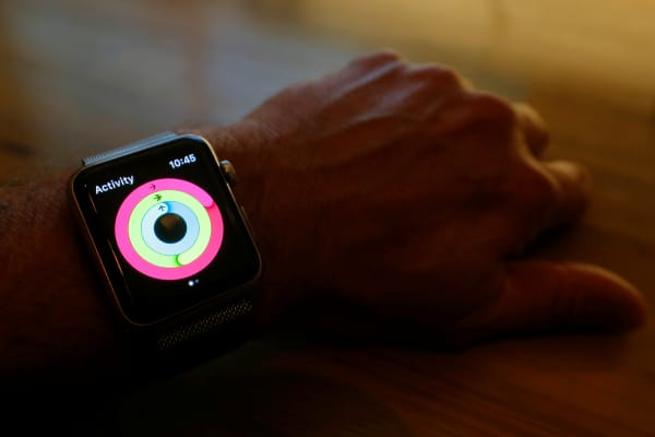 An Apple Watch activity app shows closed rings indicating completed move, exercise and standing goals for the day.