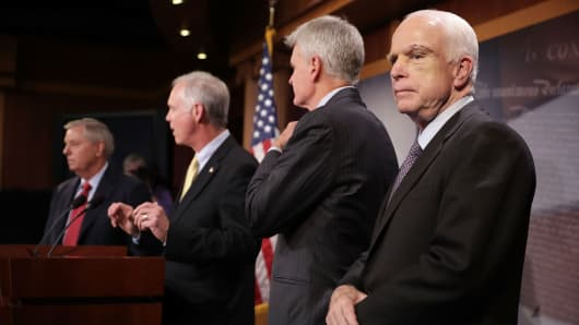 (L-R) Sen. Lindsey Graham (R-SC), Sen. Ron Johnson (R-WI), Sen. Bill Cassidy (R-LA) and Sen. John McCain (R-AZ).
