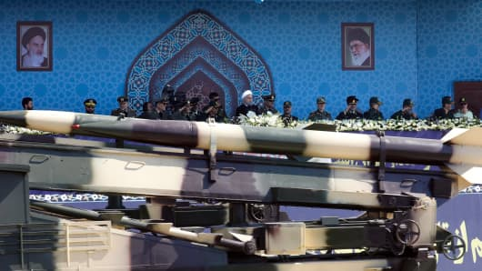 An Iranian medium range missile Zelzal passes by Iranian President Hassan Rouhani (C) during the annual military parade marking the anniversary of the outbreak of its devastating 1980-1988 war with Saddam Hussein's Iraq, on September 22, 2017 in Tehran.