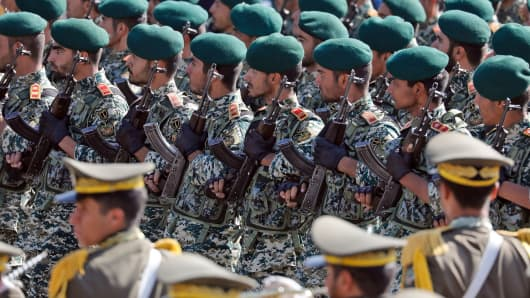 Iranian soldiers march during the annual military parade marking the anniversary of the outbreak of its devastating 1980-1988 war with Saddam Hussein's Iraq, on September 22,2017 in Tehran. President Hassan Rouhani vowed that Iran would boost its ballistic missile capabilities despite criticism from the United States and also France.