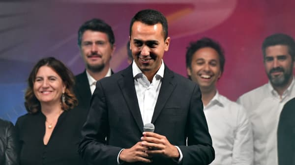Lower House Deputy speaker Luigi Di Maio (C) stands on stage after being chosen the Five Star Movement (M5S) candidate for Prime minister during a M5S party's congress in Rimini on September 23, 2017.