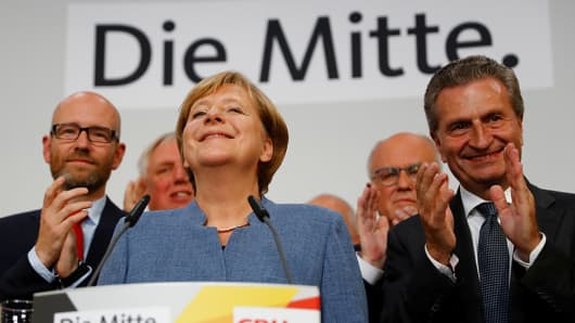Christian Democratic Union CDU party leader and German Chancellor Angela Merkel reacts on first exit polls in the German general election.