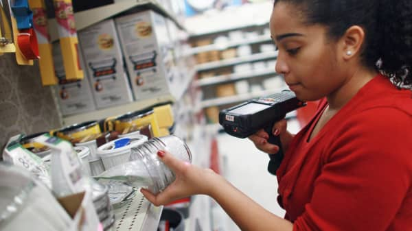 Joanely Carrero restocks shelves at a Target store, where a week ago she became a full time employee after being hired initially as a seasonal worker on January 5, 2011 in Miami, Florida.