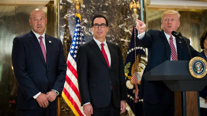 Director of the National Economic Council Gary Cohn and Treasury Secretary Steve Mnuchin look on as President Donald Trump delivers remarks following a meeting on infrastructure, at Trump Tower, August 15, 2017 in New York.