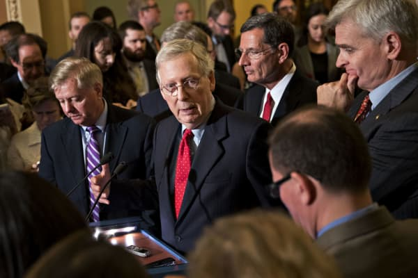 Senate Majority Leader Mitch McConnell, a Republican from Kentucky, center, speaks as Senator Lindsey Graham, a Republican from South Carolina, center left, and Senator Bill Cassidy, a Republican from Louisiana, right, listen during a news conference after a Republican policy meeting luncheon at the U.S. Capitol in Washington, D.C., U.S., on Tuesday, Sept. 19, 2017.
