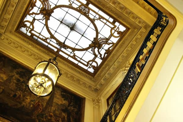 The skylight over the grand foyer is held in place by a gold-plated frame.