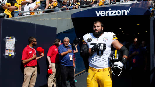 Alejandro Villanueva #78 of the Pittsburgh Steelers stands by himself in the tunnel for the national anthem prior to the game against the Chicago Bears at Soldier Field on September 24, 2017 in Chicago, Illinois.