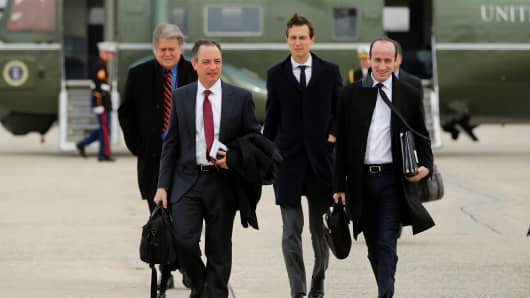White House Chief of Staff Reince Priebus (2nd L) and senior advisors Steve Bannon (L), Jared Kushner, (2nd R), and Stephen Miller (R) arrive to board Air Force One with U.S. President Donald Trump to travel to Michigan from Joint Base Andrews, Maryland, U.S., March 15, 2017.