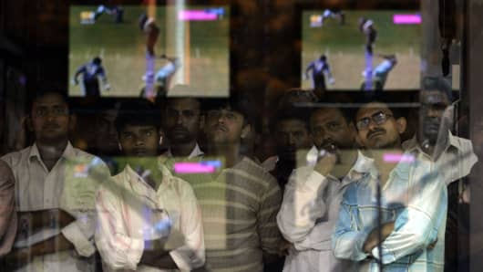 Cricket World Cup Fever Fans and Supporters watch India's World Cup match against Sri Lanka at a television shop in Mumbai in 2007/
