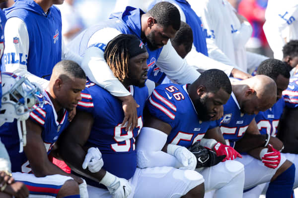 Buffalo Bills players kneel during the American National anthem before an NFL game against the Denver Broncos on September 24, 2017 at New Era Field in Orchard Park, New York.