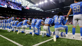 Members of the Detroit Lions take a knee during the playing of the national anthem prior to the start of the game against the Atlanta Falcons at Ford Field on September 24, 2017 in Detroit, Michigan.