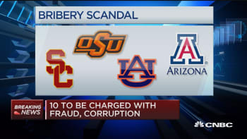 Criminal charges vs. 10 in college basketball probe