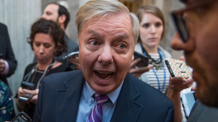 Sen. Lindsey Graham, R-S.C., talks with reporters in the Capitol after the Senate Policy luncheons on September 19, 2017.