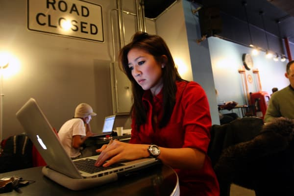 Figure skater Michelle Kwan studies in a cafe near Tufts University.