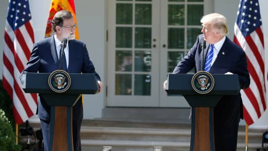 Spanish Prime Minister Mariano Rajoy and U.S. President Donald Trump look over at each other as they hold a joint news conference in the Rose Garden at the White House in Washington, U.S., September 26, 2017.