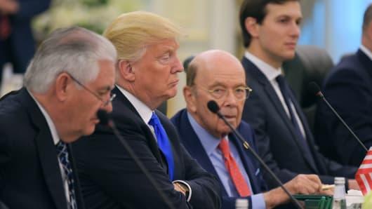 (From L) US Secretary of State Rex Tillerson, US President Donald Trump, Commerce Secretary Wilbur Ross and advisor Jared Kuchner take part in bilateral meeting with Saudi Arabia's King Salman bin Abdulaziz al-Saud at the Saudi Royal Court in Riyadh on May 20, 2017.