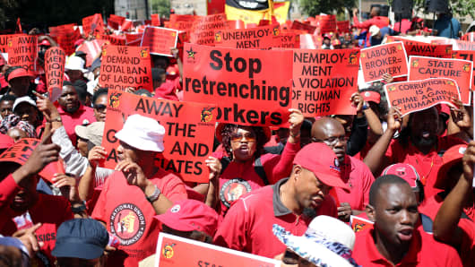 Protesters attend a demonstration organised by The Congress of South African Trade Unions (COSATU) which are pushing for a nationwide strike to protest against corruption, in Cape Town, South Africa September 27, 2017.