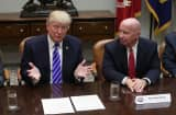 President Donald Trump (L) speaks during a meeting with members of the House Ways and Means Committee as committee chairman Rep. Kevin Brady (R-TX) (R) listens September 26, 2017 at the Roosevelt Room of the White House in Washington, DC.