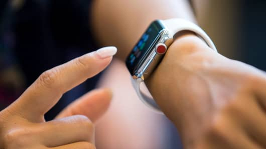 A person uses an Apple Watch Series 3 at the Apple Omotesando store on September 22, 2017 in Tokyo, Japan.