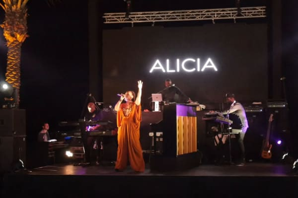 Alicia Keys performs at the Porsche Design Tower launch party.