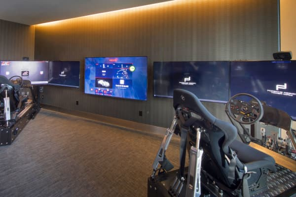 The racing simulator puts residents in the driver's seat.