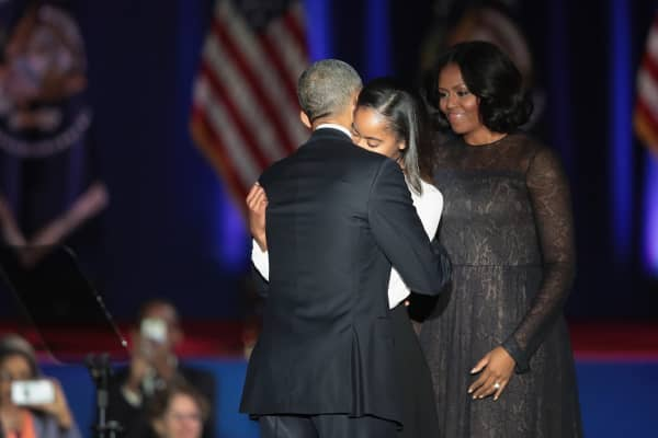 President Barack Obama hugs his daughter Malia.