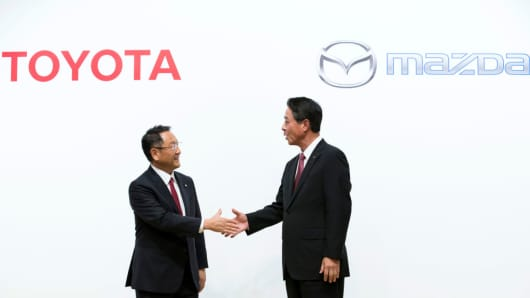 Toyota President Akio Toyoda nd Mazda President and CEO Masamichi Kogai at a joint press conference on August 4, 2017 in Tokyo, Japan.