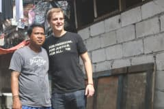 Hugh Evans (right), founder of Global Citizen, is reunited with Sonny Boy in Manila, the Philippines
