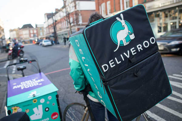 A food delivery cycle courier waits for orders from Deliveroo, operated by Roofoods, in London, U.K., on Dec. 22, 2016.