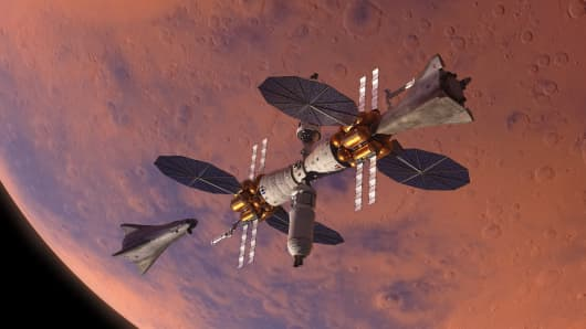Lockheed Martin's Mars Base Camp Orbiter habitat with two landers.