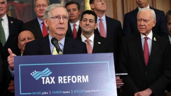 Senate Majority Leader Sen. Mitch McConnell (R-KY) speaks as Speaker of the House Rep. Paul Ryan (R-WI), Sen. Orrin Hatch (R-UT) and other congressional Republicans listen during a press event on tax reform September 27, 2017 at the Capitol in Washington, DC.