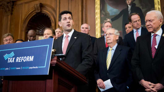Speaker of the House Paul Ryan, R-Wisc., left, Senate Majority Leader Mitch McConnell, R-Ky., and Sen. Orrin Hatch, R-Utah, participate in the Congressional GOP media availability to unveil the GOP tax reform plan in the Capitol on Wednesday, Sept. 27, 2017.