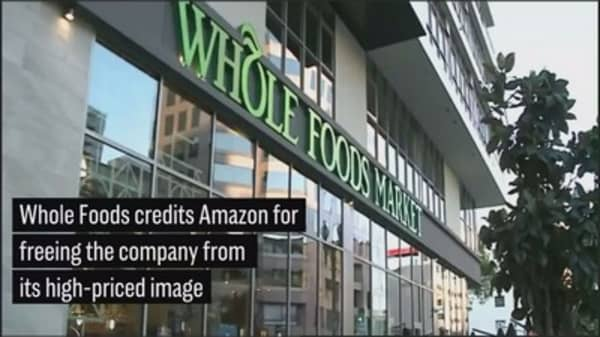 Whole Foods CEO says Amazon helped escape high-priced image