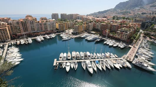 Superyachts and other smaller luxury vessels sit moored in the Port de Fontvieille in Monaco, on Monday, May 18, 2015.