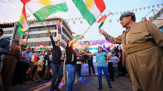 Kurds celebrate to show their support for the independence referendum in Duhok Iraq