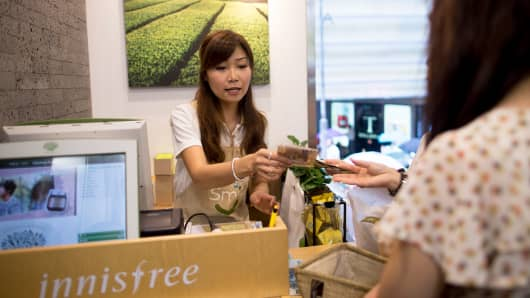 A customer pays for beauty products at Amorepacific Corp.'s Innisfree store in the Causeway Bay district of Hong Kong, China.