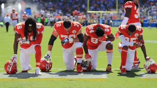 Terrance Smith #48 Eric Fisher #72 Demetrius Harris #84 and Cameron Erving #75 of the Kansas City Chiefs is seen taking a knee before the game against the Los Angeles Chargers at the Stub Hub Center