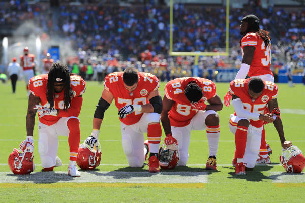 Terrance Smith #48, Eric Fisher #72, Demetrius Harris #84, and Cameron Erving #75 of the Kansas City Chiefs is seen taking a knee before the game against the Los Angeles Chargers at the StubHub Center on September 24, 2017 in Carson, California.