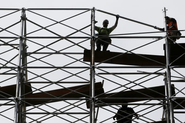Workers dismantle scaffolding at the Hudson Yards construction project in New York City.