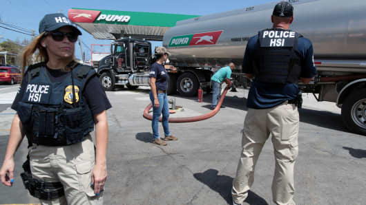 Federal agents provide security to a truck discharging gas at a gas station, after the island was hit by Hurricane Maria, in San Juan, Puerto Rico September 28, 2017.