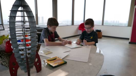 Hunter (left) and his brother Gabrien sketch some ideas at the Bottle Rocket office.