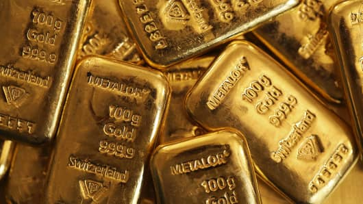 One hundred gram gold bars are seen in this arranged photograph on Tuesday, July 15, 2014.