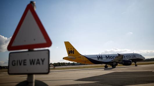 An Airbus passenger aircraft, operated by Monarch Airlines, taxis at London Gatwick airport in Crawley, U.K., on Oct. 11, 2016.