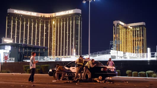 Las Vegas police stand guard along the streets outside the festival grounds of the Route 91 Harvest on October 1, 2017 in Las Vegas, Nevada. There are reports of an active shooter around the Mandalay Bay Resort and Casino.
