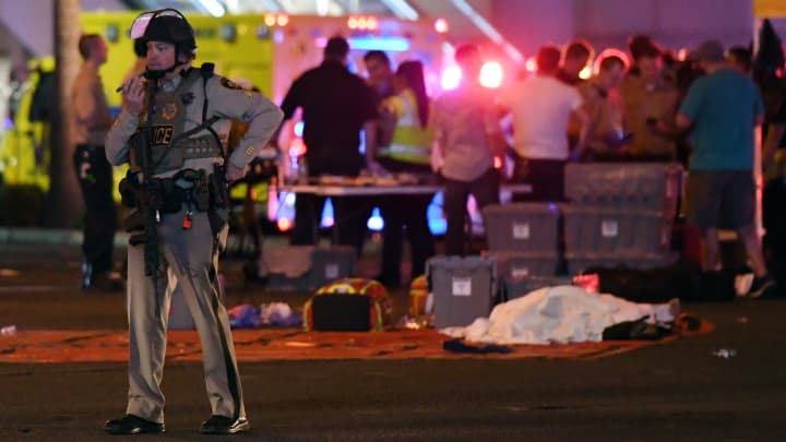 A Las Vegas Metropolitan Police officer stands in the intersection of Las Vegas Boulevard and Tropicana Ave. after a mass shooting at a country music festival nearby on October 2, 2017 in Las Vegas, Nevada.